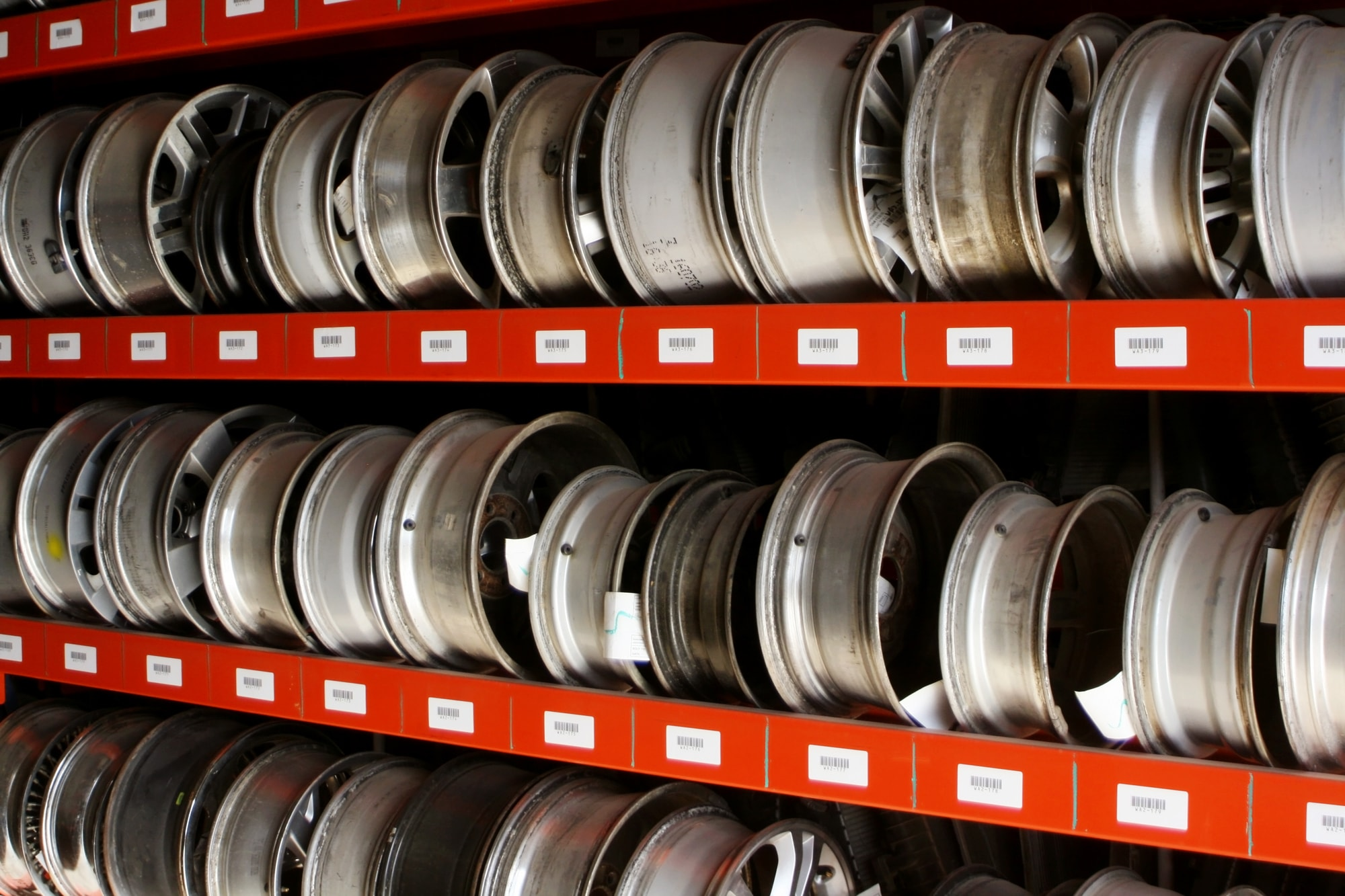 shelves of used auto rims